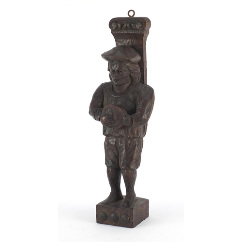 40 - Antique Continental wood carving of a peasant wearing a hat and carrying a bowl, 31.5cm high...