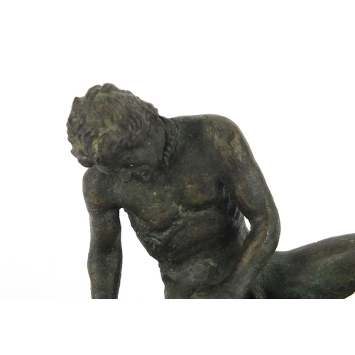 29 - Classical patinated bronze of the Dying Gaul, raised on a rectangular wooden base, 16.5cm wide...