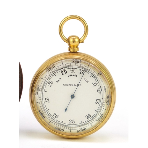 13 - Gilt brass pocket compensated barometer, housed in a velvet and silk lined leather case, 5cm in diam...