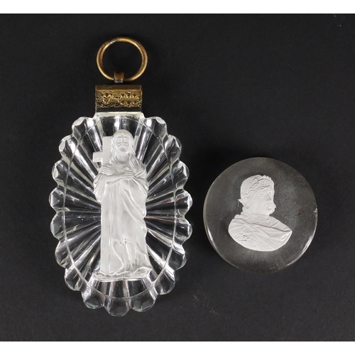53 - Baccarat sulphide pendant of Christ holding the cross, together with a 19th century sulphide plaque ...