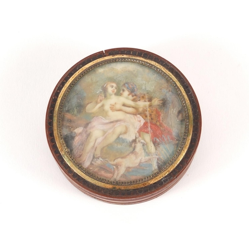 55 - 18th century circular lacquer snuff box with gold coloured mounts, metal studwork and tortoiseshell ...