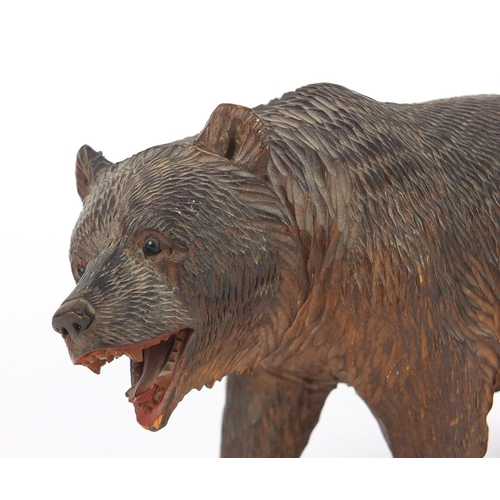 41 - Black Forest carved wood bear, 21cm in length...