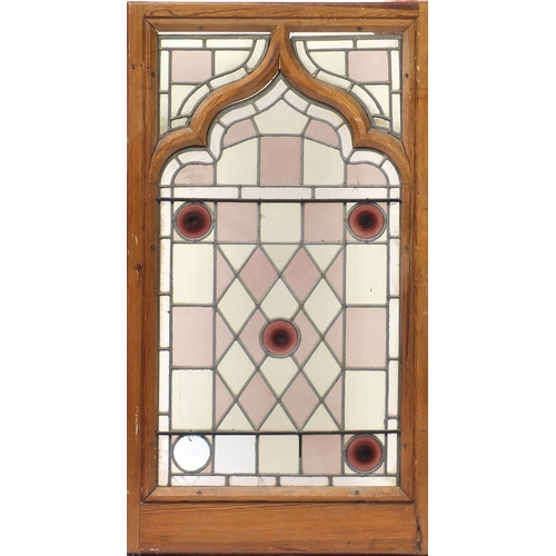 35 - * Description amended 12-09-19*Pair of pitch pine framed leaded stained glass panels, framed, each 1...