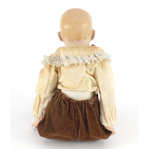 168 - German bisque headed doll of a boy, 35cm in length...