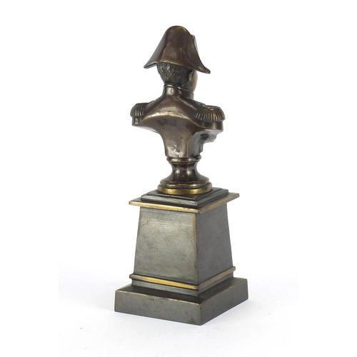 27 - Patinated bronze bust of Napoleon Bonaparte, raised on a square tapering base, overall 26cm high...