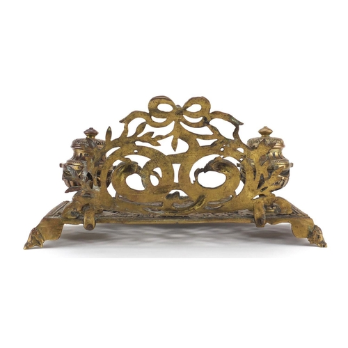 33 - 19th century gilt brass serpent and eagle design desk stand with a pair of inkwells, 34cm wide...