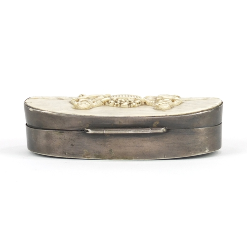 56 - Antique unmarked silver snuff box, the hinged lid inset with an ivory panel carved with two figures,...