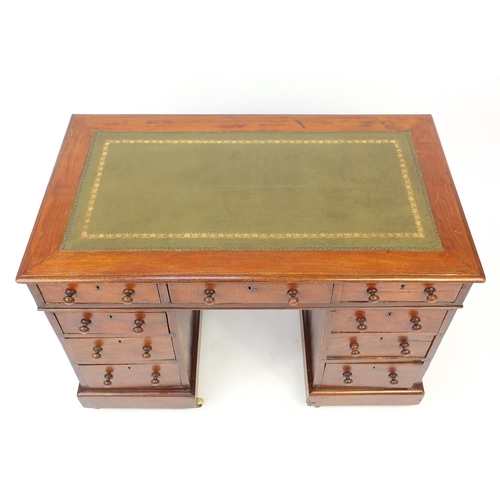 9 - Victorian mahogany twin pedestal desk with tooled green leather insert and nine drawers, 75cm H x 10...