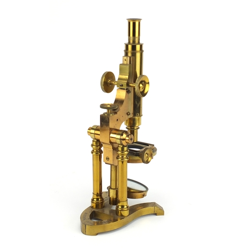18 - 19th century brass microscope by Ross of London, numbered 5219 with lenses and fitted mahogany case...