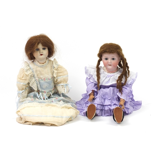 166 - Two large dolls including one with bisque head by C M Bergmann, the largest 70cm high...