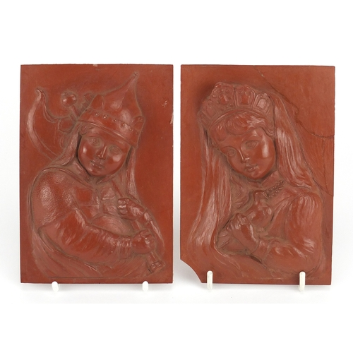 54 - Pair of continental rectangular red clay plaques, finely decorated in relief with a young boy and gi...