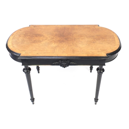 2059 - Quarter veneered and ebonised centre table raised on fluted legs, fitted with a drawer to one side, ...