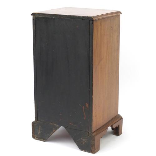 2015 - Walnut pedestal four drawer chest with pierced brass handles and bracket feet, 85cm H x 46cm W x 42c...