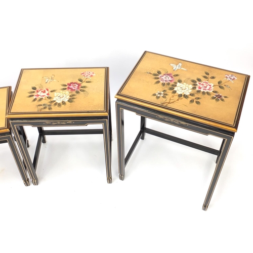 2025 - Chinese lacquered quarteto nest of tables, each decorated with birds and flowers, the largest 66cm H...