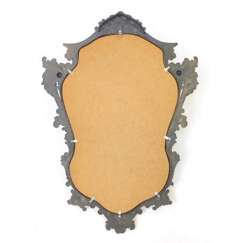 2056 - Ornate gilt framed cartouche shaped mirror, 74cm x 54cm...