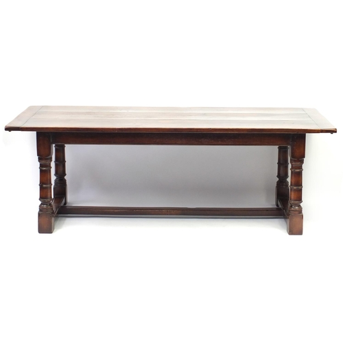 2019 - Oak refectory table with cannon barrel legs united by a H stretcher, 76cm H x 223cm W x 98cm W...