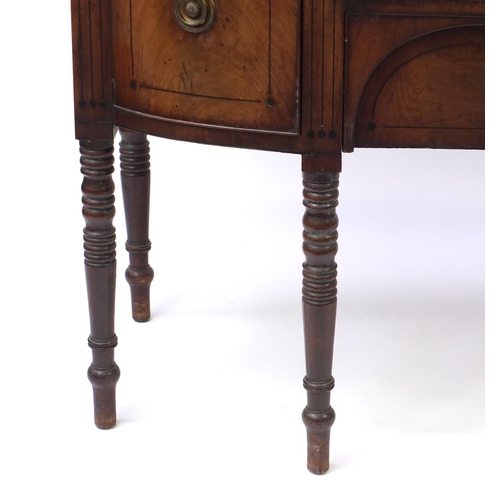 2035 - Regency mahogany six legged sideboard with line inlay, two central doors and two drawers, one with w...