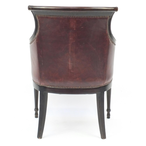 2041 - Mahogany and brown leather library chair on tapering legs, 91cm high...