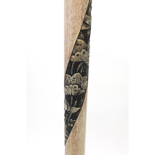 2060 - Chinese limed wood standard lamp carved with flowers, having a silk lined shade, overall 187cm high...