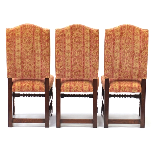 2020 - Set of six oak framed dining chairs with bobbin turned legs, having red and gold geometric upholster...