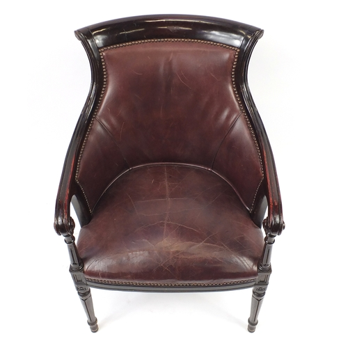 2040 - Mahogany and brown leather library chair on tapering legs, 91cm high...