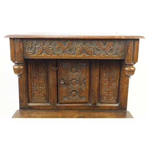 2038 - Ipswich oak side cabinet carved with foliate motifs, 121cm H x 72cm W x 44cm D...