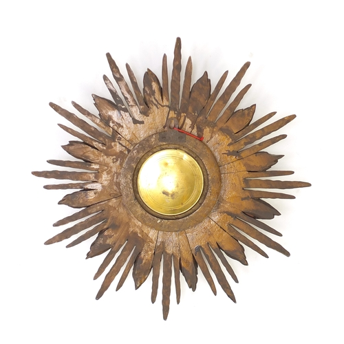2057 - Vintage gilt wood sunburst design wall clock, with silvered dial and Arabic numerals, impressed '26'...