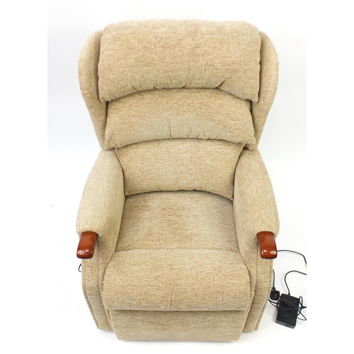 17 - Celebrity beige upholstered electric rise and recline armchair...