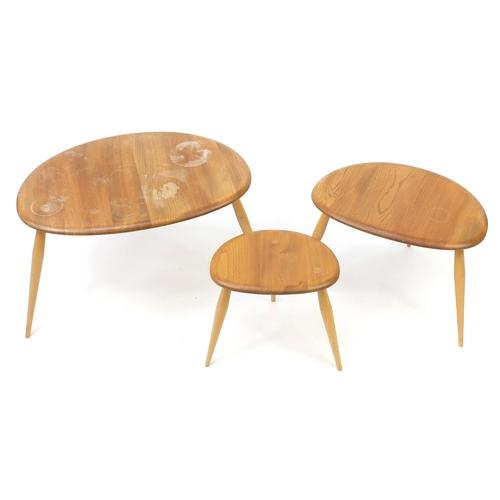 1 - Nest of three Ercol light elm pebble tables, the largest 40.5cm H x 65cm W x 44cm D...