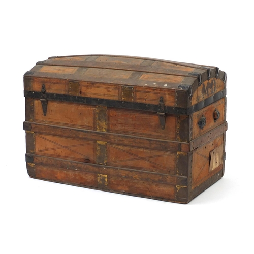 7 - Vintage dome topped leather and wooden bound travelling trunk, with His Majesty's Service labels, 54...