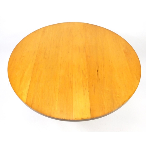 42 - Circular maple dining table, with cast iron base, 76cm high x 120cm in diameter...