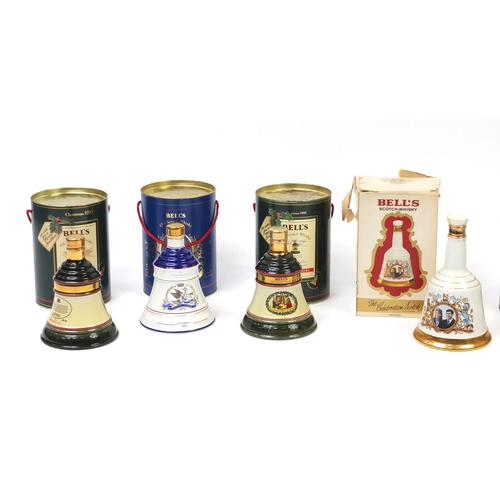 2044 - Seven Bells scotch whisky decanters with contents and boxes...