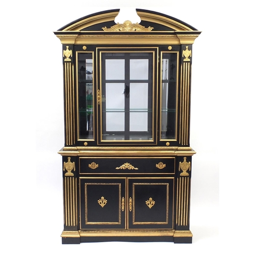 2009 - Italian style black and gold painted display cabinet with bevelled glass door, above a single drawer...