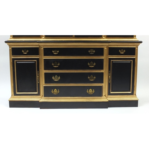 2002 - Italian style black and gold painted display cabinet with four glazed doors above a series of drawer...