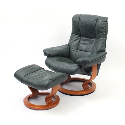 2011 - Ekornes stressless green leather easy chair and foot stool, 100cm high...