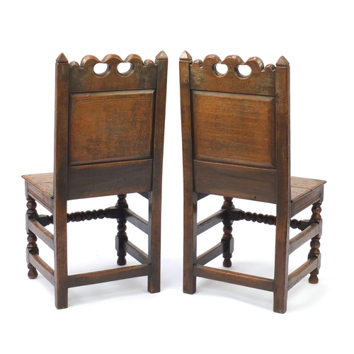 2019 - Pair of mid 19th oak chairs with carved panel backs, 102cm high...