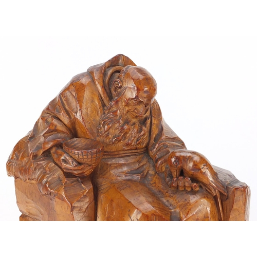 27 - Two 19th century continental wood carvings of monks, the largest 32.5cm high...