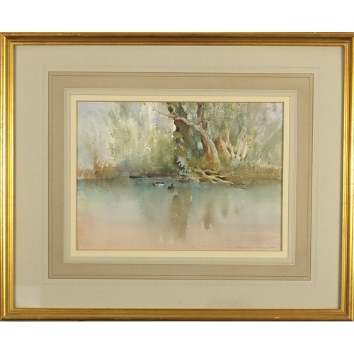2056 - Ian Armour-Chelu 1983 - Trees by a still pond, watercolour, labels and inscriptions verso, mounted a...