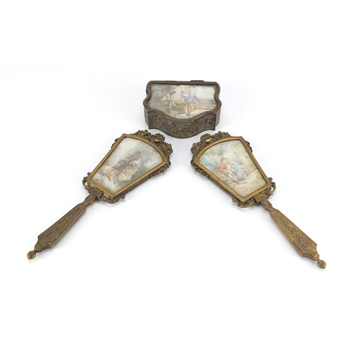 51 - 19th century French ornate brass dressing table items, comprising two hand mirrors and a jewel box, ...