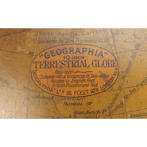 26 - Geographia 10 inch terrestrial globe raised on an ebonised stand, 48cm high...