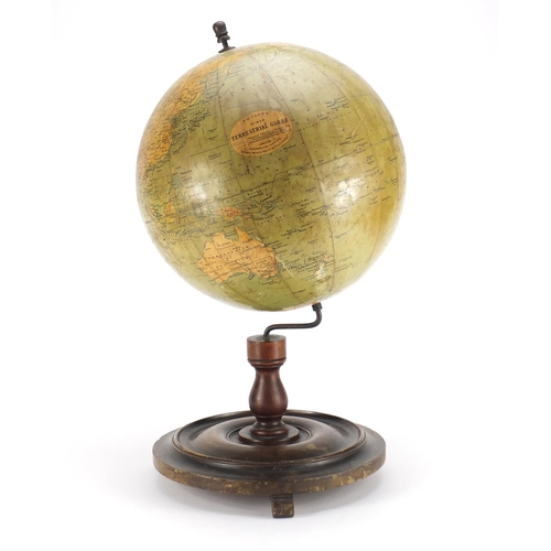 25 - Philips 12inch terrestrial globe raised on a stained mahogany base, 52cm high...