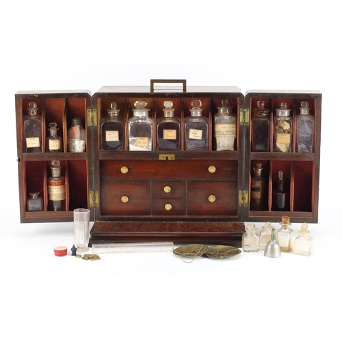 28 - 19th century mahogany apothecary table cabinet with inset brass carry handle and secret compartment,...