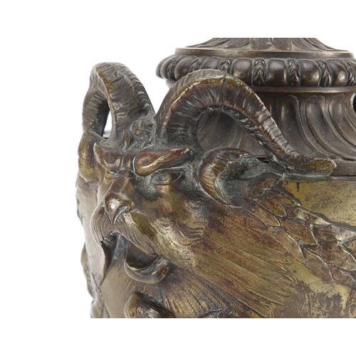 13 - 19th century classical patinated bronze urn and cover with rams head handles, cast in relief with fr...