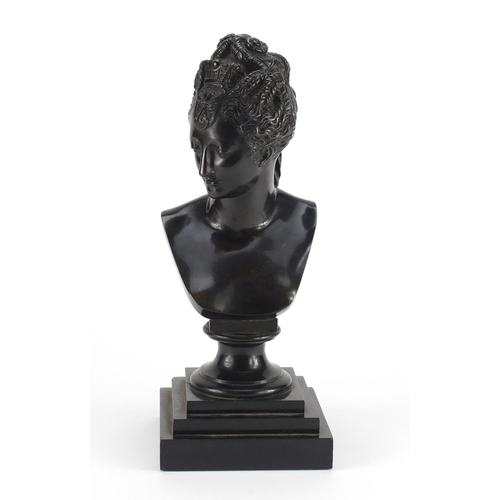 7 - 19th century classical patinated bronze bust of a nude female, raised on a square stepped black slat...