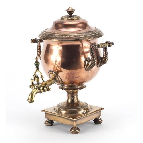 21 - Early 19th century copper and brass samovar with stained ivory handles by Best of London, 34cm high...