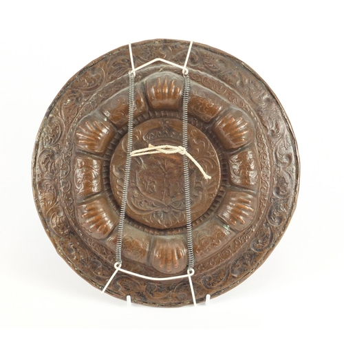 22 - Antique copper plate embossed with a heraldic crest, 27.5cm in diameter...