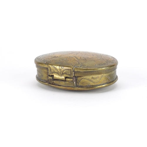48 - Antique Dutch oval brass tobacco box, engraved with flowers, dated 1687, 8.5cm wide...