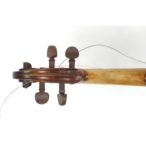 168 - Old wooden violin with wooden travelling case, the violin bearing a Pietro Antonius label to the int...