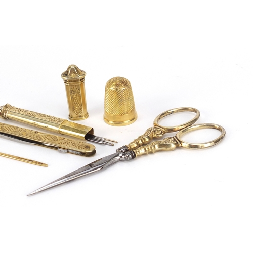53 - 19th century French ivory necessaire housing silver gilt implements including scissors, needle case ...