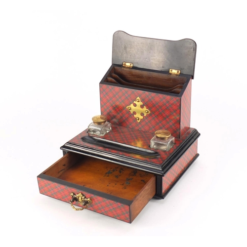 30 - Victorian Tartanware desk stand, fitted with a letter rack and a pair of glass inkwells above a base...